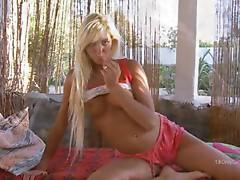 Charming blonde masturbating pussy