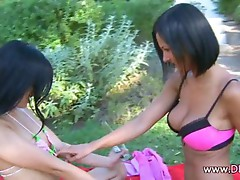 Blackhaired lezzies licking in the grass