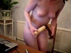 A sweety girlie is pleasing herself with just a dildo into the asshole!