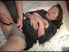Amateur granny shows tits and poses in sexy nylons