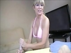 Bikini-dressed cutie massages someone's pump